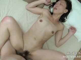 Anorectic Asian mature with hairy cunt fucked by young cock